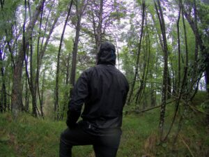 Montane Minimus Jacket - From the back in heavy rain