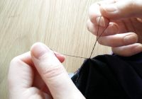 After having the needle one last time, you only pull it so far that you have enough thread on each side to comfortably tie a knot.