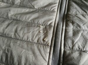 Synthetic jacket does not absorb the water droplets as fast a fleece