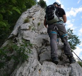 Resting along the Furlanova Pot via ferrata