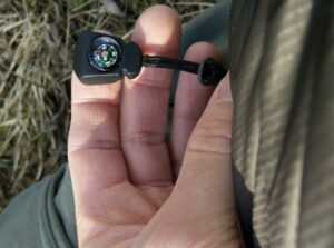CimAlp Laos Hiking Pants: A small working compass on hand pocket's pull loop