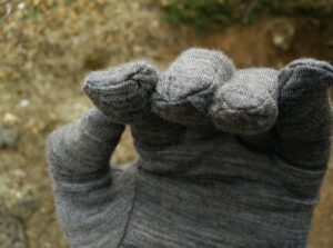 Isobaa Merino Liner Gloves: Stitches come with a lot of excess fabric which decrease the dexterity to some extent