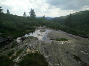 Gjuvvatnet Hiking Trail - here you cross over the hillside stream to find narrow path