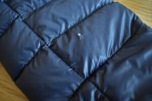 How to Repair a Down Jacket - a clear patch will let the insulation be seen through