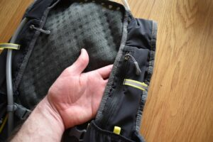 Nathan VaporAir 2.0 Hydration Vest: The vest has two zippered pockets on the shoulder straps